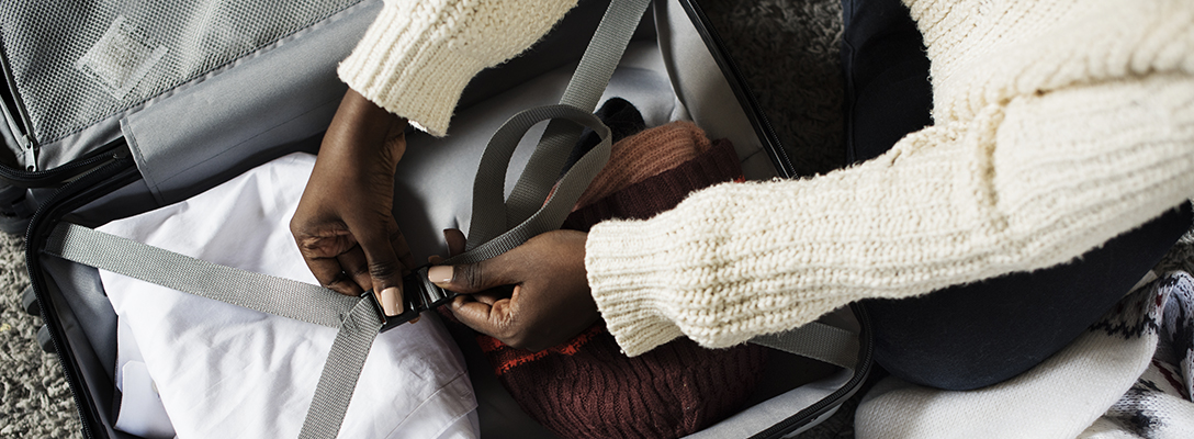Person Packing Suitcase for Winter in Vegas