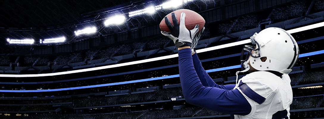 Pro Football Player Catching Ball During Game